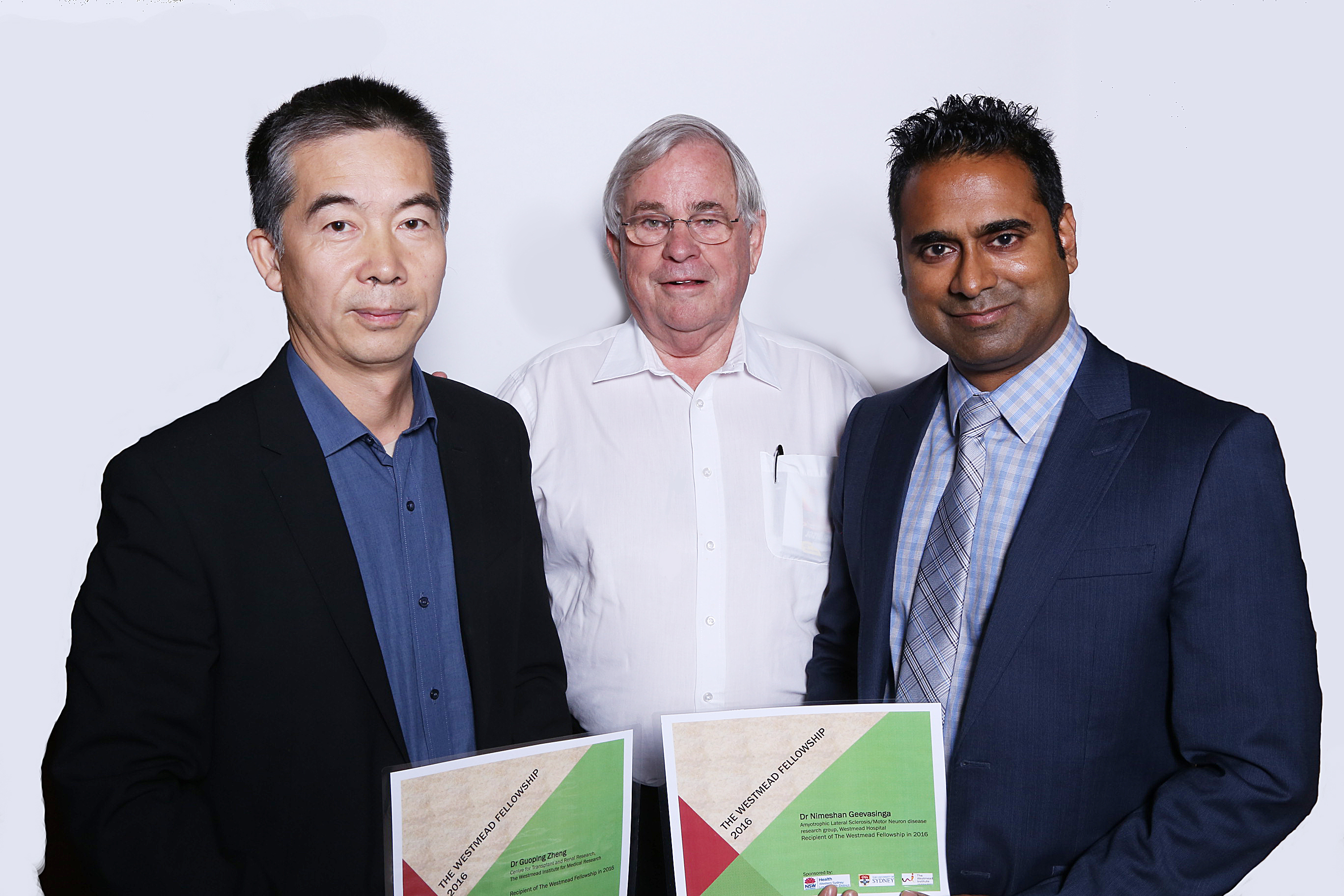 WSLHD Research and Education director Emeritus Professor Stephen Leeder (centre) presents Dr Zheng (left) and Dr Geevasinga